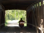 Riding across covered bridge